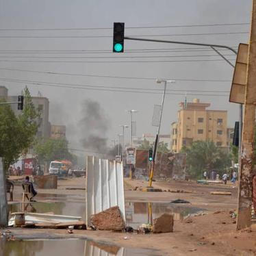 Smoke rises behind barricades laid by protesters in the Sudanese capital Khartoum on Wednesday, June 5, 2019.