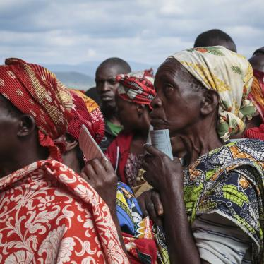 Women queue to cast their votes in the presidential election, in Giheta, Gitega province, Burundi, May 20, 2020.