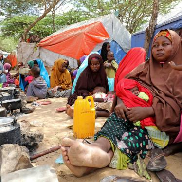 Somali families, displaced after fleeing the Lower Shabelle region amid an uptick in US airstrikes, rest at an internally displaced persons camp near Mogadishu, Somalia, March 12, 2020. © March 12, 2020 REUTERS/Feisal Omar.
