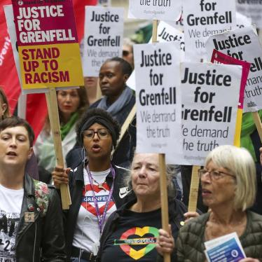 Campaigners hold placards as they take part during the Justice for Grenfell Solidarity rally against the lack of action by the Government following the Grenfell Tower fire, which took the lives of 72 people.