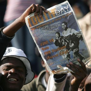 FILE: A South African youth holds a placard during the commemoration of the 30th anniversary of the uprisings in Soweto, South Africa, Friday, June 16, 2006.