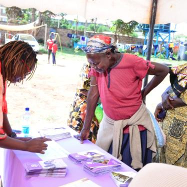 Women registering for a community dialogue meeting organized by the Federation of Women Lawyers in Kenya (FIDA-Kenya) with the Milimani Law Courts in Kibera, Nairobi.