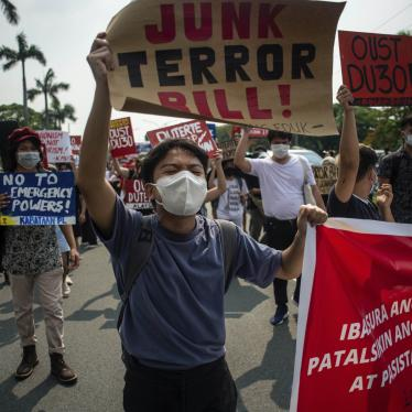 A protester carries a sign at a rally against the draft Anti-Terrorism Act in Quezon City, Philippines, June 4, 2020.