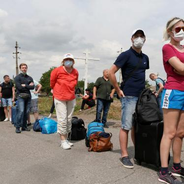 People queue before leaving the territory of the self-proclaimed Donetsk People's Republic and crossing a separation line with Ukraine at a checkpoint, which was temporary closed due to the Covid-19 outbreak and then reopened, in Donetsk Region, Ukraine. June 22, 2020.