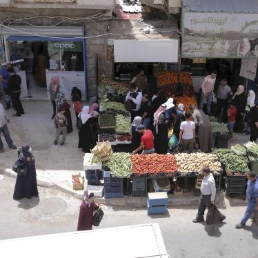 People shop for vegetables at the main market in Karak, Jordan, after a curfew was lifted for some southern cities, amid concerns about the coronavirus Wednesday, April 22, 2020.