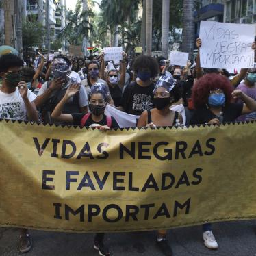 "People protest against police killings in front of the Guanabara Palace, the residence of the Rio de Janeiro State Governor, on May 31, 2020. One sign reads ""Black Lives Matter."""