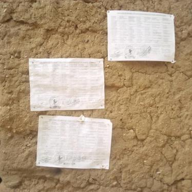 "Lists of civilians forced by the military into night guard duty displayed on a wall at the Mozogo market, Far North region, Cameroon. At the bottom of the lists are instructions from local authorities: ""Each shift supervisor and each soldier on duty are required to call and notify those who reported for duty and those who did not to punish the latter. The shift begins at 7:00 pm and ends at 4:00 am."" April 2020,"