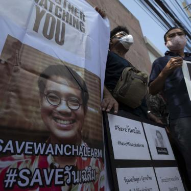 Demonstrators hold photos of Thai activist Wanchalearm Satsaksit and demand information on his whereabouts since his enforced disappearance, at a rally outside the Cambodian embassy in Bangkok, Thailand,  June 8, 2020.