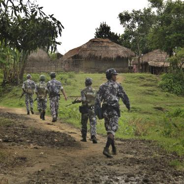 Myanmar border guard police officers walk along a path in Tin May village in northern Rakhine State, Myanmar, July 14, 2017.