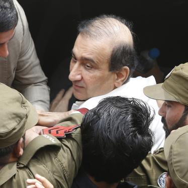 Pakistani police escort Mir Shakilur Rehman to court following his arrest in Lahore, Pakistan, March 13, 2020.