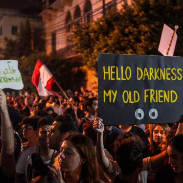 "A protester holds up a placard reading, ""Hello Darkness My Old Friend,"" in front of the Lebanese electricity company headquarters, during protests against the Lebanese government and corruption, in Beirut, Lebanon, November 7, 2019."