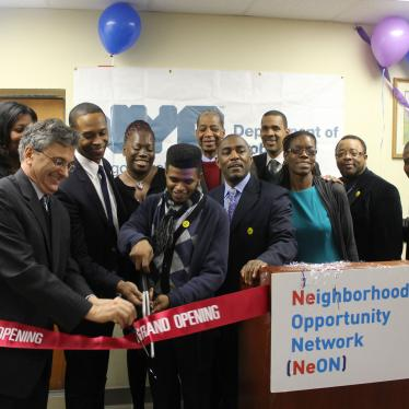 Former Commissioner Vincent Schiraldi and others cut a ribbon at the opening of the Neighborhood Opportunity Network at the New York City Department of Probation.