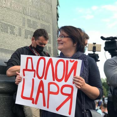"Yuliya Galyamina holding placard ""Down with the Tsar"", July 2020, Moscow"