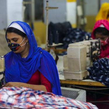 Workers sew clothes in a garments factory in Dhaka, Bangladesh, July 25, 2020.