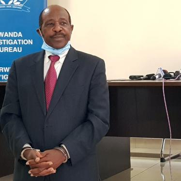 Paul Rusesabagina, who was detained on August 27, 2020, is paraded in front of the media in handcuffs at the headquarters of the Rwanda Investigation Bureau in Kigali, Rwanda on August 31.