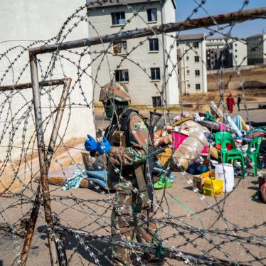 A South Africa soldier guards the entrance of a housing development while flats are being emptied in Johannesburg, South Africa, Wednesday Aug. 12, 2020.