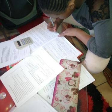 Keshia completes her homework in her family's home in Johannesburg in August 2020. ©2020 Private