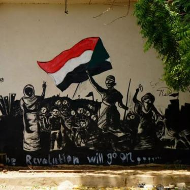 "A mural reading, ""The Revolution will go on"" is seen on a wall in Khartoum, Sudan, June 18, 2019."