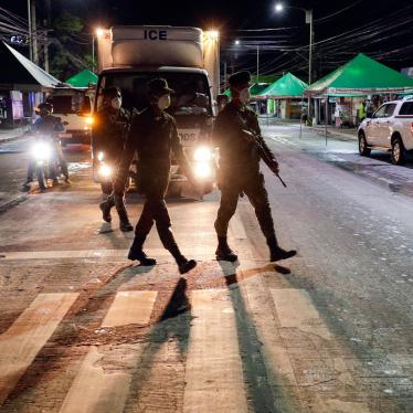 Filipino army troopers patrol a street in the Philippines in the early morning, March 15, 2020.