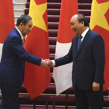 Japan's Prime Minister Yoshihide Suga, left, shakes hands with Vietnam's Prime Minister Nguyen Xuan Phuc after the exchange of documents at the Government Office in Hanoi on Monday, October 19, 2020.