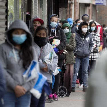 A line of people in face masks