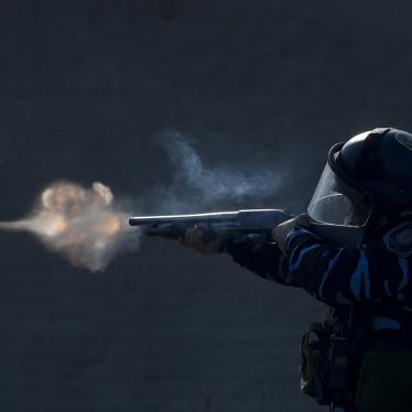 A police officer aims his weapon, as security forces fire tear gas and rubber bullets, during clashes with people after police broke up a squatters camp and evicted people living there in Guernica, Buenos Aires province, Argentina, Thursday, on Oct. 29, 2020.