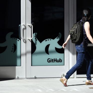 A pedestrian walks past the GitHub Inc. offices in San Francisco, California, United States