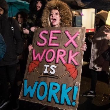 People take part in an International Women's Day march in London, England, against criminalization of sex work