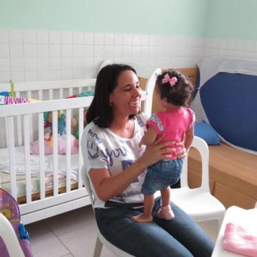 A mother with her 3-year-old adoptive daughter, who has developmental disabilities.