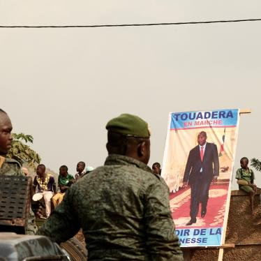 Presidential guards stand guard in Bangui, on December 12, 2020, during the opening campaign rally for incumbent president Faustin-Archange Touadéra, seen in the poster, a candidate in the December 2020 elections.