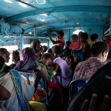 People who fled the conflict in Ethiopia's Tigray region ride a bus to the Village 8 temporary shelter near the Sudan-Ethiopia border, in Hamdayet, eastern Sudan, December 1, 2020.