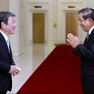 Cambodian Prime Minister Hun Sen, right, greets with Japanese Foreign Minister Toshimitsu Motegi, left, before a meeting at the Peace Palace, in Phnom Penh, Cambodia on Saturday, August 22, 2020.