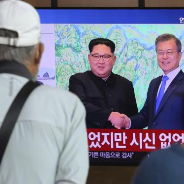 People watch a news program showing an image of North Korean leader Kim Jong Un, left, and South Korean President Moon Jae-in, right, at the Seoul Railway Station in Seoul, South Korea on Friday, Sept. 25, 2020.