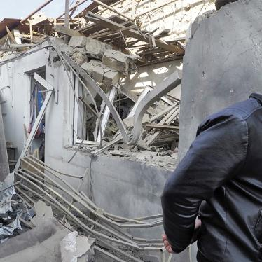 A man walks past a shop damaged in an attack by Azerbaijani forces on Stepanakert, Nagorno-Karabakh.