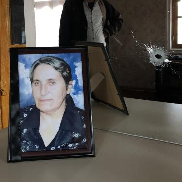 Yashar Abbasov keeps a photograph of his wife, Raziya Abbasova, on a dresser with a mirror which was damaged in the attack that killed her.