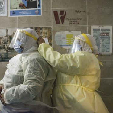 A nurse helps a colleague put on personal protective equipment at the 6th of October Central Hospital, an isolation hospital for Covid-19 patients, in Giza, Egypt, in July 2020.