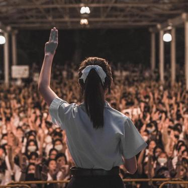 A high school student holds up the three-finger salute and gives a speech at a youth-led rally in Chiang Mai, Thailand on August 25, 2020. © 2020 Supitcha Chailom