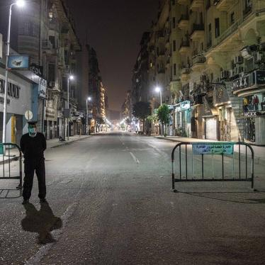 Egyptian security forces cordon off roads during curfew hours as prevention measures due to the coronavirus outbreak, in Cairo, Egypt, Sunday, March 29, 2020