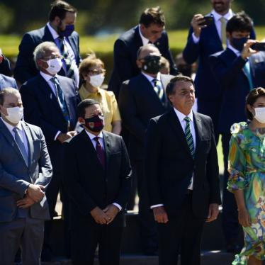 Brazil's President Jair Bolsonaro, without a mask, attends a ceremony at the Presidential Palace in Brasilia, along with ministers and other authorities, most of whom are wearing mask, on September 7, 2020.