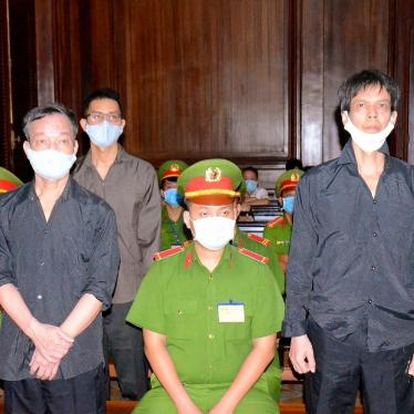 Photo released by the Vietnam News Agency on January 5, 2021 shows Vietnamese bloggers Pham Chi Dung (right), Nguyen Tuong Thuy (front left), and Le Huu Minh Tuan (back left) during their trial in Ho Chi Minh city.