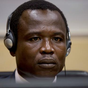 Dominic Ongwen, a Ugandan commander in the Lord's Resistance Army, waits for the judge to arrive as he made his first appearance at the International Criminal Court in The Hague, Netherlands, Monday, Jan. 26, 2015.