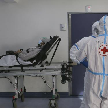 Red Cross volunteers waiting with a coronavirus patient for a place in the intensive care unit of Rafic Hariri University Hospital, Beirut, January 11, 2021.