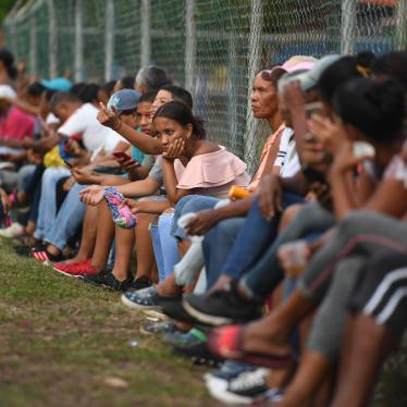 Relatives and friends of Venezuelan migrants who died when a boat transporting them to Trinidad and Tobago sank, wait for news of the recovery of their bodies, in Güiria, Venezuela, on December 18, 2020.