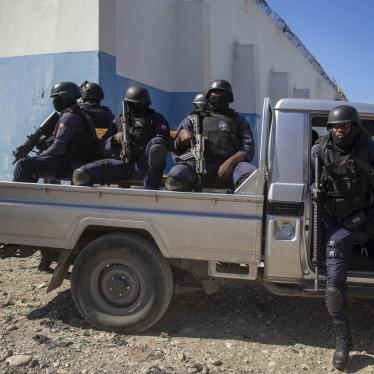 Heavily armed police are part of the group delivering Supreme Court justice Yvickel Dabrésil along with other detained individuals into custody at the penitentiary in Croix-des-Bouquets, Haiti, Feb. 9, 2021.