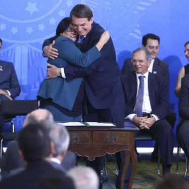 Brazilian President Jair Bolsonaro embraces the Minister of Women, Family, and Human Rights, Damares Alves, during a ceremony on August 29, 2019, in Brasilia, Brazil. ©Agência Brasil / Valter Campanato
