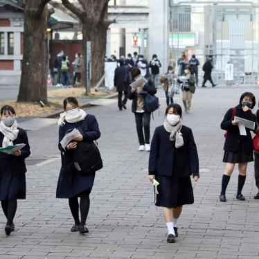 High school students wearing face masks walk in Tokyo, January 16, 2021.