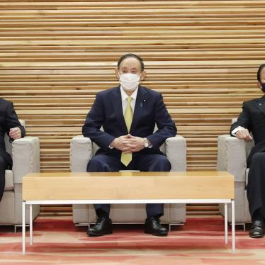 Japanese Foreign Minister Toshimitsu Motegi (left), Prime Minister Yoshihide Suga (center), and Finance Minister Taro Aso (right) attend a Cabinet meeting in Tokyo on February 24, 2021.