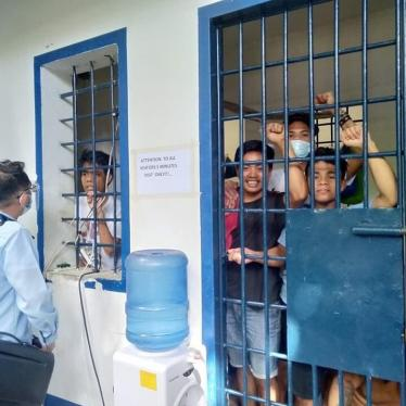 Arrested teachers and adult Indigenous students confer with their lawyer while detained in a Cebu City jail.