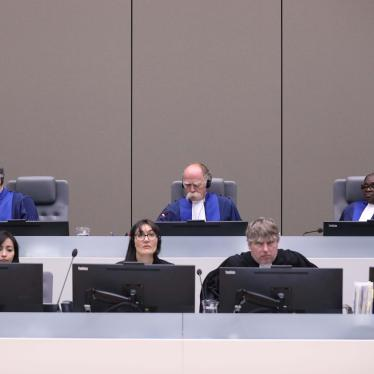 Marc Perrin de Brichambaut, Péter Kovács, and Reine Alapini-Gansou are the three pre-trial chamber judges assigned to the Palestine situation at the International Criminal Court (ICC). The photo shows them in an ICC hearing related to Mali on July 8, 2019.