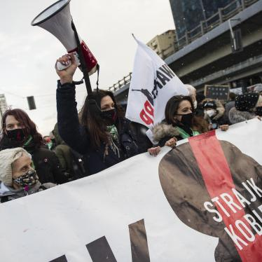 Protesters hold a banner of Strajk Kobiet (Women's Strike) during a protest in Warsaw on March 8,  International Women's Day, organized by the Women's Strike (Strajk Kobiet) against the ruling Law and Justice (PiS) party and the decision of the Constitutional Court.
